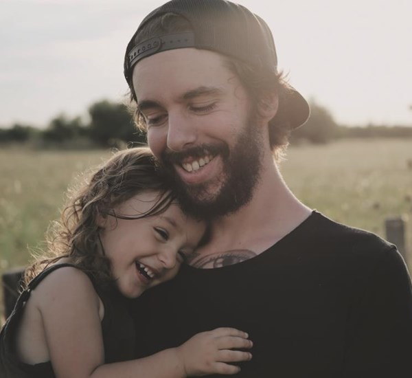 Man With Daughter In The Countryside