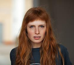 Red Haired Woman With Fringe
